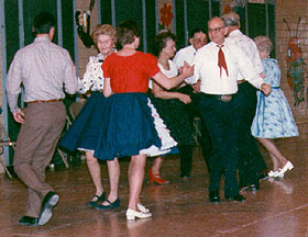 [Color photograph of square dancers]